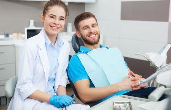 Happy patient with a dentist