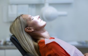 woman sleeping on the dentist chair
