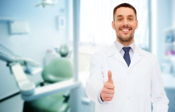 Happy dentist with thumbs up