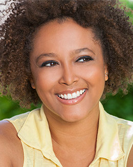 smiling woman with dark curly hair