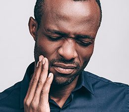 a black man with toothache