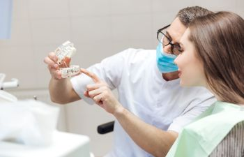 Dentist and Patient Consulting About Dental Implants Roswell GA
