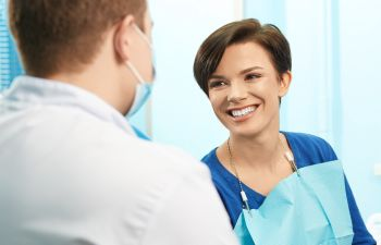 Woman Talking with Dentist while in Dental Chair Roswell, GA
